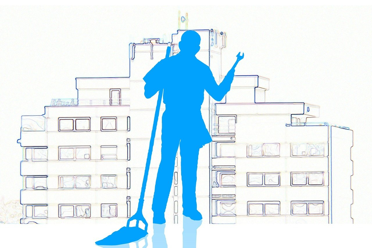 drawing of commercial building with silhouette of man with wrench in one hand and mop in anotherf